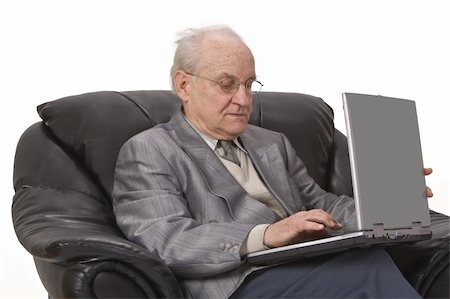 Close-up image of a senior man using a laptop.Shot with Canon 70-200mm f/2.8L IS USM Stock Photo - Budget Royalty-Free & Subscription, Code: 400-04003638