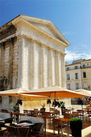 Roman temple Maison Carree and outdoor cafe in city of Nimes in southern France Stock Photo - Budget Royalty-Free & Subscription, Code: 400-04003811