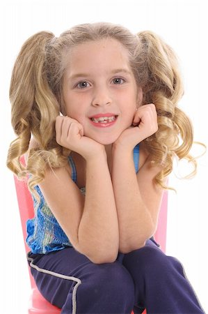 happy little girl with curly pig tails Stock Photo - Budget Royalty-Free & Subscription, Code: 400-04003933