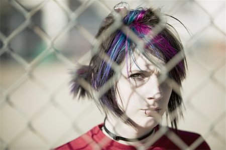 running away scared - Young Punk Girl Being Shadowed By Chain Link Stock Photo - Budget Royalty-Free & Subscription, Code: 400-04016564