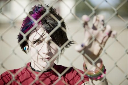 running away scared - Young Punk Girl Being Shadowed By Chain Link Stock Photo - Budget Royalty-Free & Subscription, Code: 400-04016565