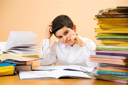 little boy has troubles with homeworks and is scratching his head Stock Photo - Budget Royalty-Free & Subscription, Code: 400-04019484