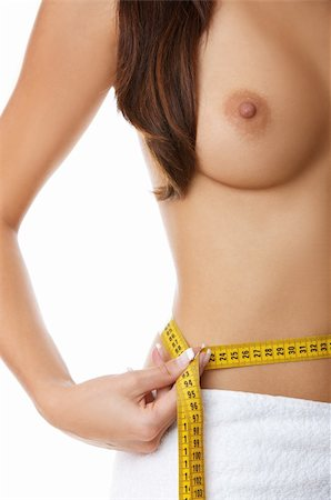 Woman measuring her waist Stock Photo - Budget Royalty-Free & Subscription, Code: 400-04025017