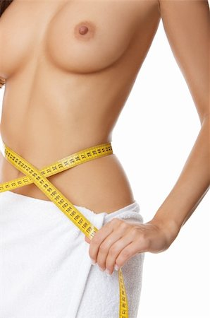 Woman measuring her waist Stock Photo - Budget Royalty-Free & Subscription, Code: 400-04025019