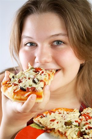 fat italian woman - Beautiful no make-up girl eating a piece of Pizza Stock Photo - Budget Royalty-Free & Subscription, Code: 400-04025292
