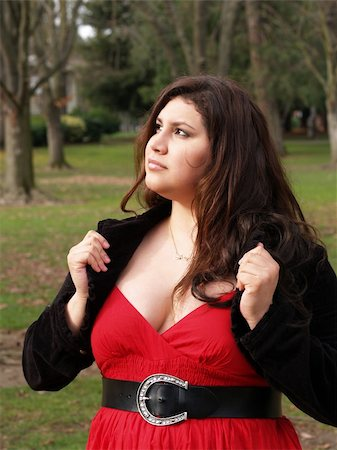 plus-size woman outdoors in jacket and red dress Stock Photo - Budget Royalty-Free & Subscription, Code: 400-04028537