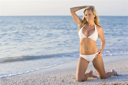 simsearch:400-04002563,k - A beautiful bikini clad blond on a beach in golden sunlight Stock Photo - Budget Royalty-Free & Subscription, Code: 400-04020396