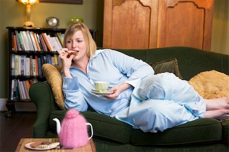 A young woman lying on her couch drinking tea Stock Photo - Budget Royalty-Free & Subscription, Code: 400-04037707