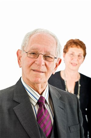 closeup  portrait off a senior businessman with colleague in the background isolated on white Stock Photo - Budget Royalty-Free & Subscription, Code: 400-04038469