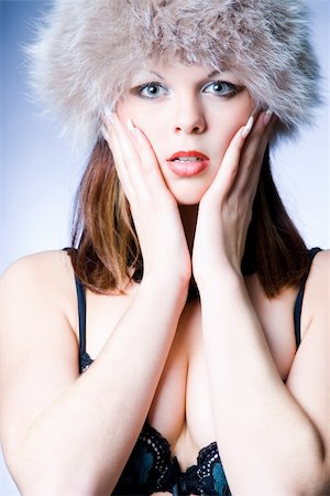 Sensual girl in fur hat studio shot Stock Photo - Budget Royalty-Free & Subscription, Code: 400-04030281