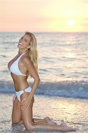 simsearch:400-04002563,k - A beautiful bikini clad blond kneeling in the surf at sunset Stock Photo - Budget Royalty-Free & Subscription, Code: 400-04031134