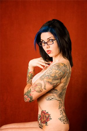 Pretty young woman with many tattoos on her back and arms Stock Photo - Budget Royalty-Free & Subscription, Code: 400-04032502