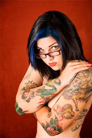 Pretty young woman with many tattoos crossing her arms Stock Photo - Budget Royalty-Free & Subscription, Code: 400-04032503