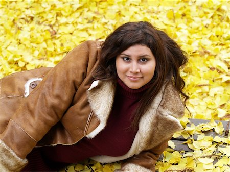 young plump woman wearing jacket fall leaves Stock Photo - Budget Royalty-Free & Subscription, Code: 400-04032838