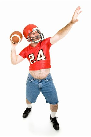 fat man balls - Middle aged former football player reliving his glory days.  Full body isolated on white. Stock Photo - Budget Royalty-Free & Subscription, Code: 400-04044185