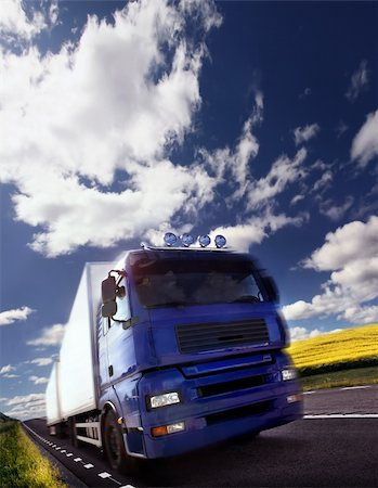 truck driving at dusk/motion blur Stock Photo - Budget Royalty-Free & Subscription, Code: 400-04048835
