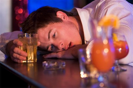 drunk passed out - Drunk young man resting head on bar counter Stock Photo - Budget Royalty-Free & Subscription, Code: 400-04040230