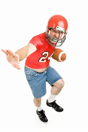 fat man balls - Middle aged man in his high school football jersey and helmet, reliving his past.  Isolated on white. Stock Photo - Budget Royalty-Free & Subscription, Code: 400-04040335