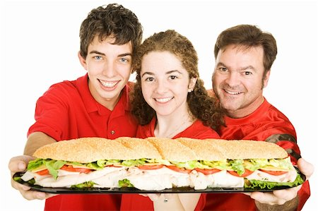Football fans holding a giant submarine sandwich.  Isolated on white. Stock Photo - Budget Royalty-Free & Subscription, Code: 400-04040336