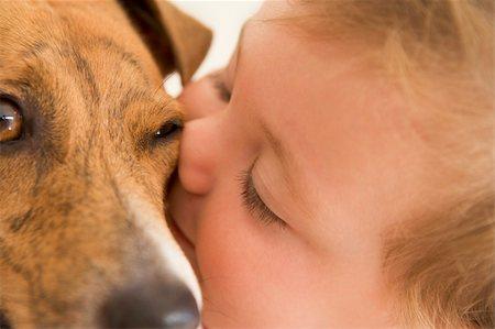 dog kissing girl - Baby kissing dog Stock Photo - Budget Royalty-Free & Subscription, Code: 400-04041727