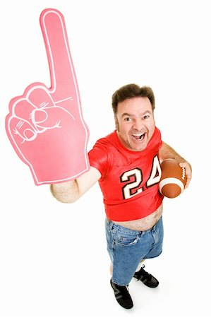 Enthusiastic middle aged football fan holding a football and wearing a foam finger.  Full body isolated on white. Stock Photo - Budget Royalty-Free & Subscription, Code: 400-04042109