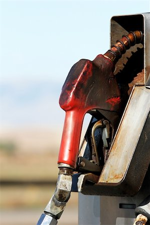 rural gas station - gas pump close up in rural area - dirty grungy greasy with copyspace Stock Photo - Budget Royalty-Free & Subscription, Code: 400-04042446