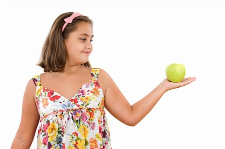 Adorable girl with flowered dress with a apple on a white background Stock Photo - Budget Royalty-Free & Subscription, Code: 400-04050270