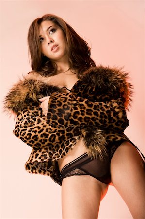 pressmaster (artist) - View from below of sexy woman in black panties and leopard jacket Stock Photo - Budget Royalty-Free & Subscription, Code: 400-04051325