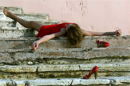 dead female body - woman playing dead, lying on the stairs Stock Photo - Budget Royalty-Free & Subscription, Code: 400-04052191