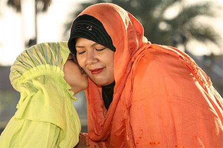 daughter kissing mother - Muslim Mother and Child   Kiss Stock Photo - Budget Royalty-Free & Subscription, Code: 400-04053915