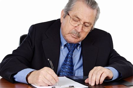 Senior businessman taking notes a over white background Stock Photo - Budget Royalty-Free & Subscription, Code: 400-04066330