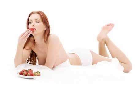 picture of lovely girl with strawberry in bed Stock Photo - Budget Royalty-Free & Subscription, Code: 400-04067791