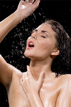 picture of wet brunette girl over black Stock Photo - Budget Royalty-Free & Subscription, Code: 400-04067972