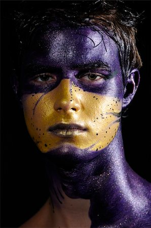 Portrait of young handsome male model wearing artistic bodypaint drawing Stock Photo - Budget Royalty-Free & Subscription, Code: 400-04062119