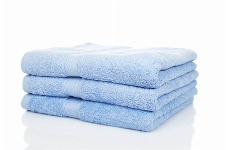 A blue towels stacked reflected on white background Stock Photo - Budget Royalty-Free & Subscription, Code: 400-04062354