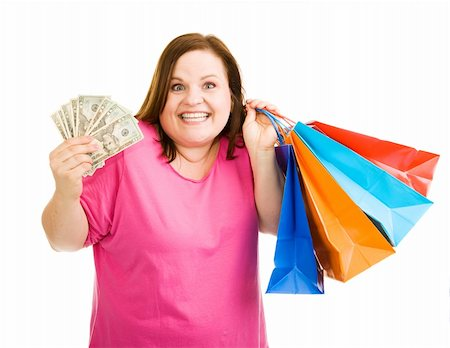 Beautiful plus-sized model holding cash in one hand and shopping bags in the other.  Isolated on white. Stock Photo - Budget Royalty-Free & Subscription, Code: 400-04062400