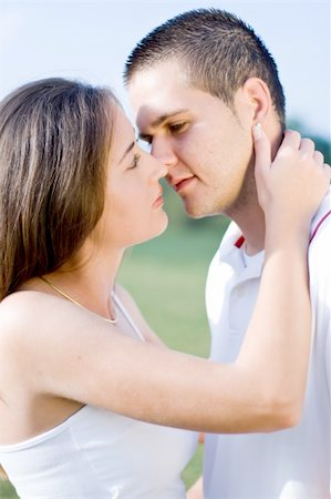 young couple kissing Stock Photo - Budget Royalty-Free & Subscription, Code: 400-04075263