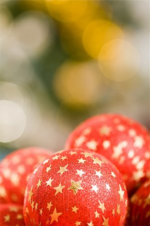 simsearch:400-05749231,k - Close-up of red decorative ball with golden stars on its surface in background of other toys Stock Photo - Budget Royalty-Free & Subscription, Code: 400-04075402