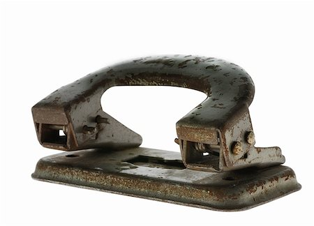 Old rusty puncher. It was used 1930-1960 in offices of the USSR Stock Photo - Budget Royalty-Free & Subscription, Code: 400-04075664