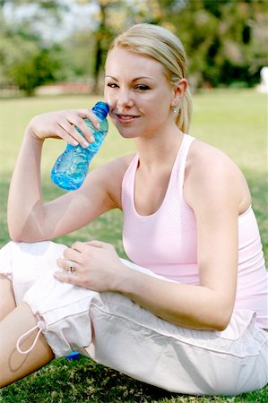 sweaty woman - blond woman drink water after fitness workout Stock Photo - Budget Royalty-Free & Subscription, Code: 400-04075797