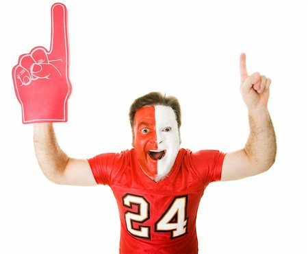 fat man balls - Enthusiastic sports fan with foam finger raises his arms in the Number One gesture.  Isolated on whit. Stock Photo - Budget Royalty-Free & Subscription, Code: 400-04076327