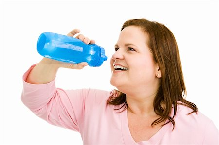 Beautiful plus-sized woman drinking water after her workout.  Isolated on white. Stock Photo - Budget Royalty-Free & Subscription, Code: 400-04070946