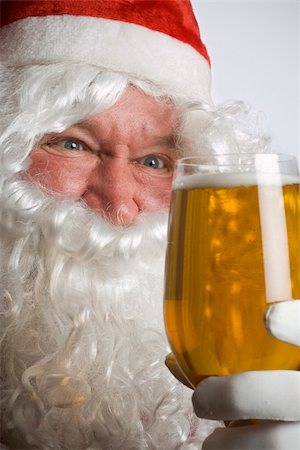 Father Christmas Santa looks at a lovely glass of beer Stock Photo - Budget Royalty-Free & Subscription, Code: 400-04071878