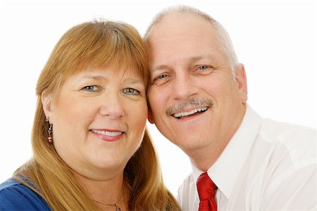 Beautiful mature couple in love.  Headshot over white background. Stock Photo - Budget Royalty-Free & Subscription, Code: 400-04073371
