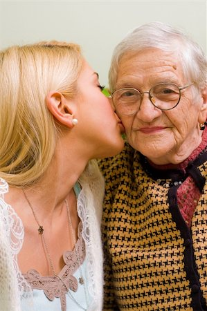 A young woman kissing an older one  (focus on the elderly) - part of a series. Stock Photo - Budget Royalty-Free & Subscription, Code: 400-04081831