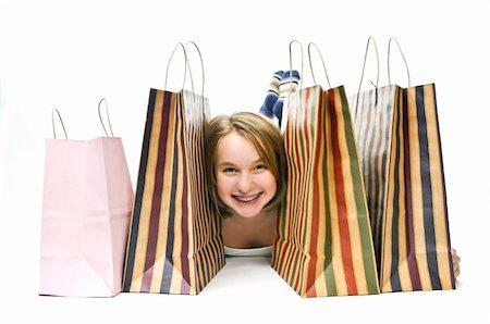 preteen girl feet - Happy teenage girl with lots of shopping bags Stock Photo - Budget Royalty-Free & Subscription, Code: 400-04083823