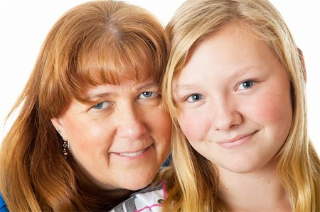 Closeup portrait of a beautiful blond, blue-eyed mother and daughter. Stock Photo - Budget Royalty-Free & Subscription, Code: 400-04094582