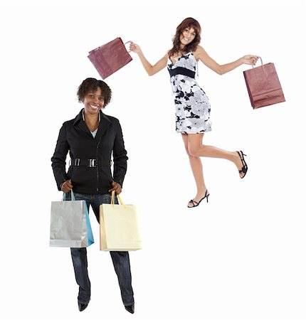 Two girls shopping on a over white background Stock Photo - Budget Royalty-Free & Subscription, Code: 400-04097414