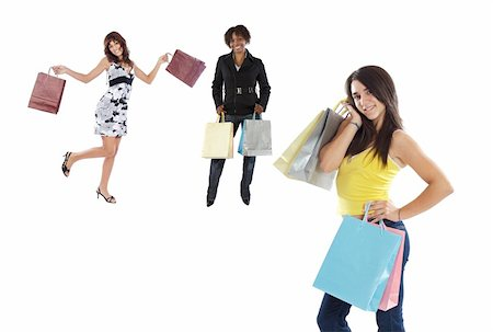 Three girls shopping on a over white background Stock Photo - Budget Royalty-Free & Subscription, Code: 400-04097413