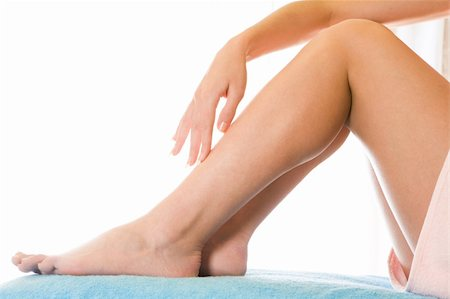 Close-up of soft female legs after depilation over white background Stock Photo - Budget Royalty-Free & Subscription, Code: 400-04106319